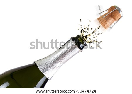 Bottle of champagne with splashes over white background - stock photo