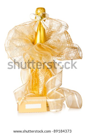 Bottle of champagne with wedding decoration, flower boutonniere and invitation card on white background