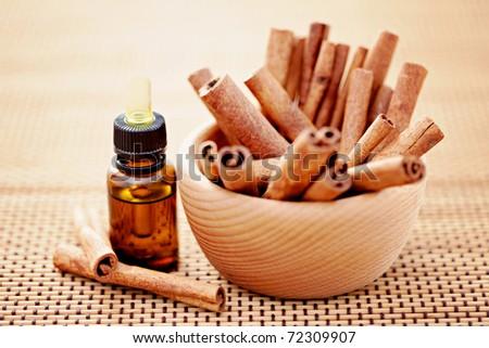 bottle of cinnamon essential oil - beauty treatment