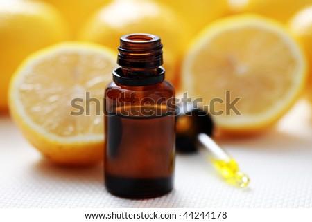 bottle of essential oil from lemon - alternative medicine - stock photo