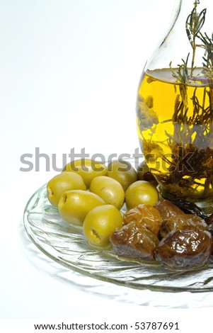 bottle of extra greek virgin olive oil and olives