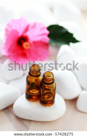 bottle of hibiscus essential oil - beauty treatment