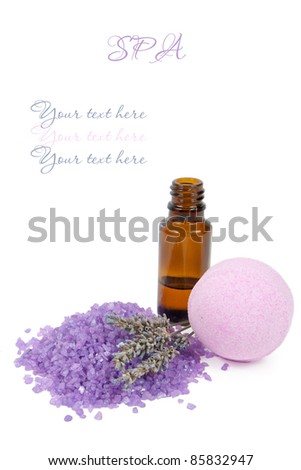 Bottle of lavender essential oil and spa salt bomb isolated on white background with the sample text
