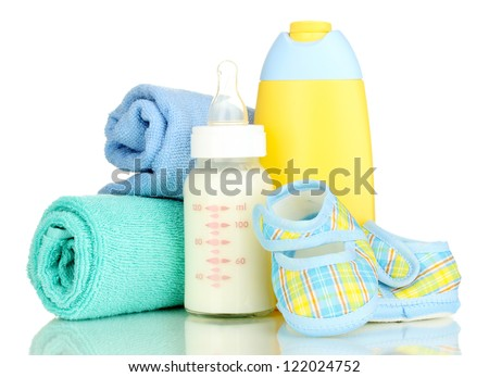 Bottle of milk, pacifier, shampoo and towel isolated on white