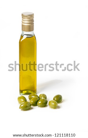 Bottle of olive oil with olives, on white background