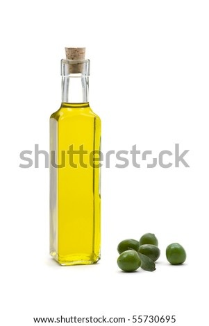 Bottle of olive oil with olives over white background