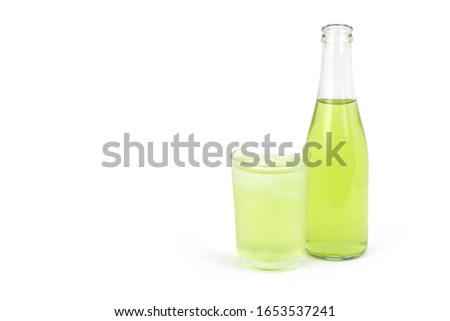 Bottle of pandan juice and glass of   pandanus ice tea isolated on white  background. Natural herbal plant, fragrant screw pine and healthy drinks concept.