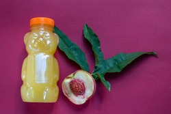 bottle of peach nectar, fresh peach juice, top view, copy space, cold juice