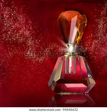 bottle of perfume on a dark red background