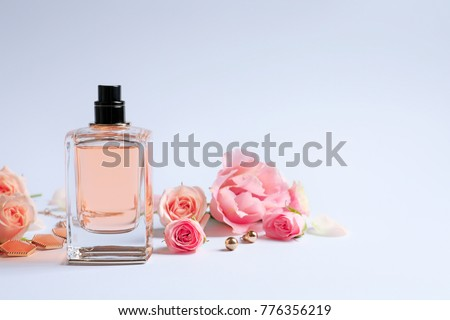 Bottle of perfume with flowers on white background #776356219