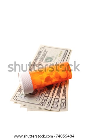 bottle of pills laying on money