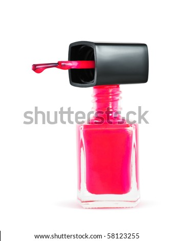 Bottle of pink nail polish with a nail polish dripping from brush, on white background