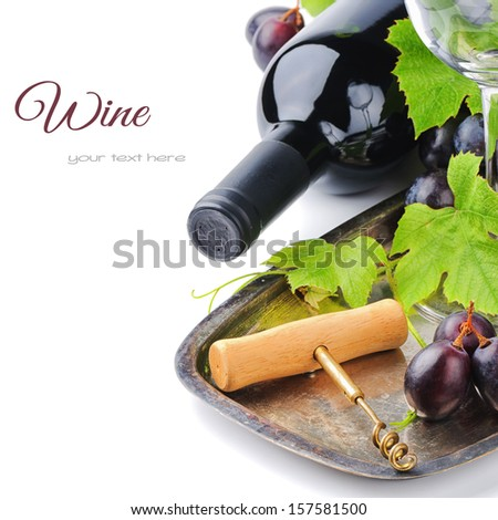Bottle of red wine and and corkscrew on silver tray - stock photo