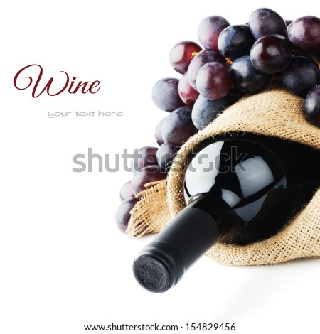 Bottle Of Red Wine And Freshly Harvested Grape