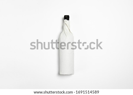 Bottle of Red Wine Mock-up wrapped in craft paper on white background.High resolution photo. Stock photo ©