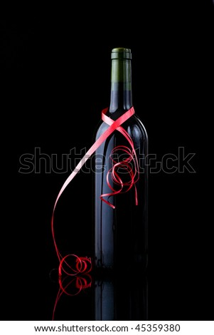 stock photo : Bottle of red wine wrapped in a red ribbon, Valentines day