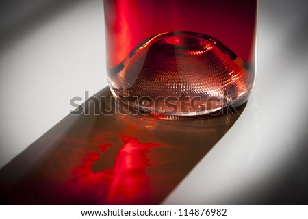 Bottle of rose wine  with vibrant shadow and black vignette