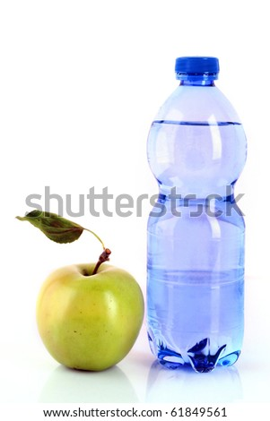 Bottle of sparkling water and green apple isolated on white