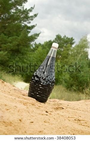 bottle of vine in a sand