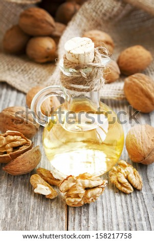 Bottle of walnut oil with walnuts  and kernels,healthy fats