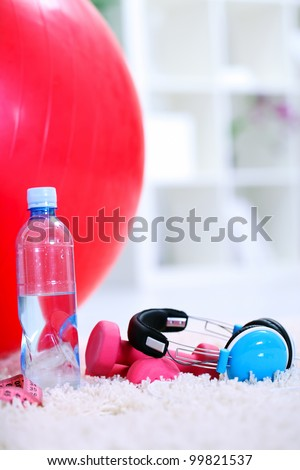 bottle of water, Pilates ball  and dumbbells,  equipment for exercise