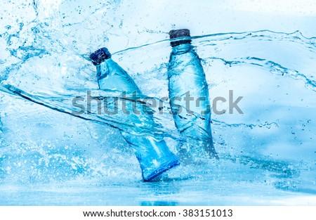 Bottle of water splash on a blue background