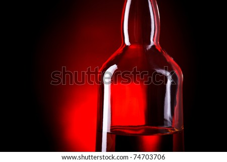 bottle of whiskey on deep red background
