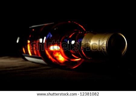 Bottle of whisky on black crisp background - stock photo