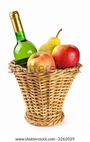 Bottle of white wine and fruit in a basket isolated