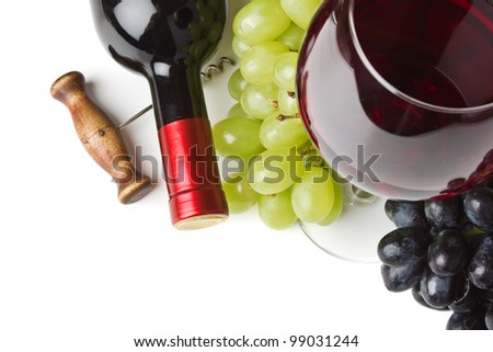 bottle of wine and grapes isolated on white background