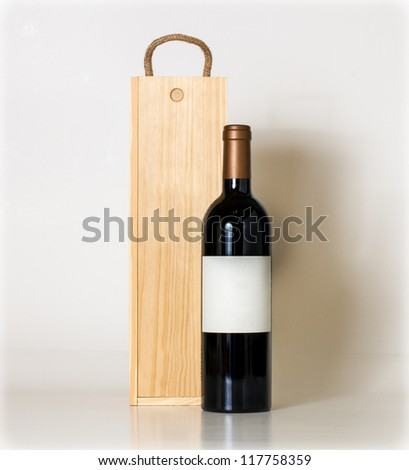 Bottle of wine and wooden box.