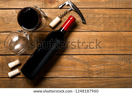 Bottle of wine corkscrew and corkscrew on wooden background. Top view with copy space. #1248187960