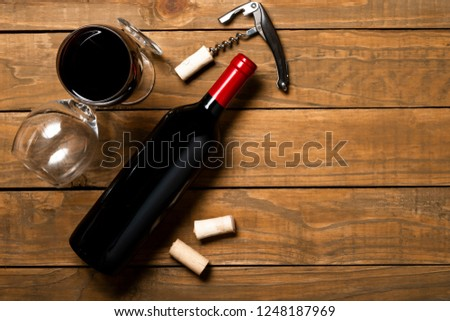 Bottle of wine corkscrew and corkscrew on wooden background. Top view with copy space. #1248187969