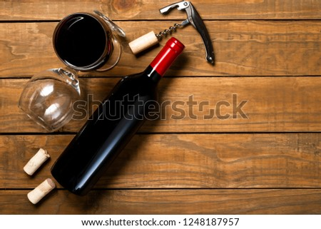 Bottle of wine glasses corkscrew and corkscrew on wooden background. Top view with copy space. #1248187957