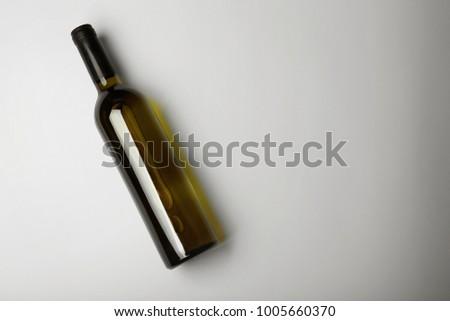 Bottle of wine on light background #1005660370