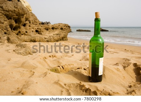 bottle of wine on the beach