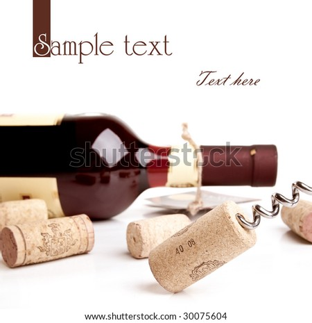 Bottle of wine with corkscrew isolated on white