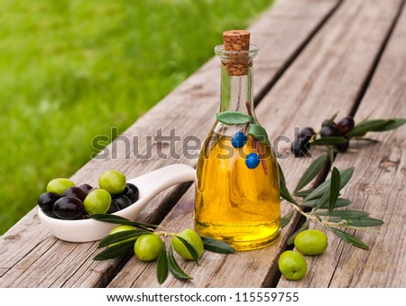 Bottle  olive oil with fresh black and green olives