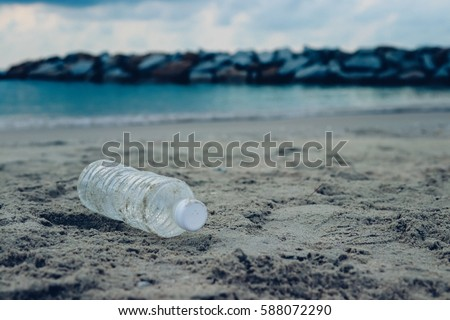 Bottle plastic on stone ground show long life garbage concept #588072290
