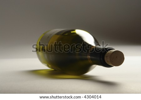 Bottle white blame, on light-gray background