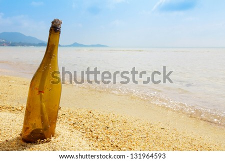 Bottle with a message on tropical island