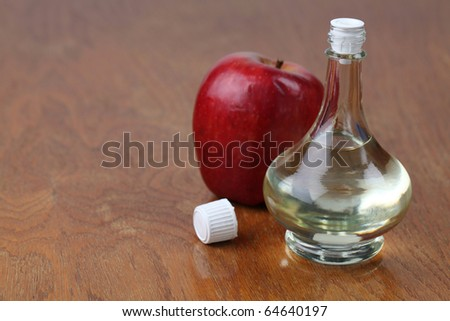 Bottle with apple vinegar and fresh apple. Shallow dof