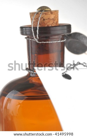 bottle with  cosmetic mean closed by  stopper isolated on white #41495998