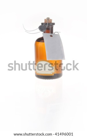bottle with  cosmetic mean closed by  stopper isolated on white #41496001