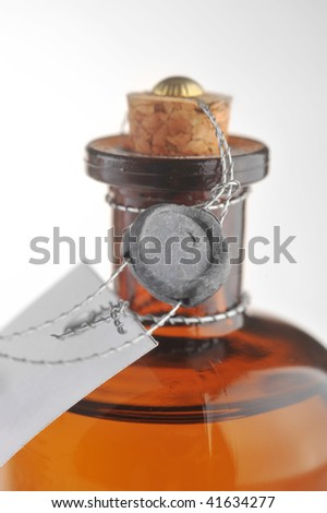 bottle with  cosmetic mean closed by  stopper isolated on white #41634277