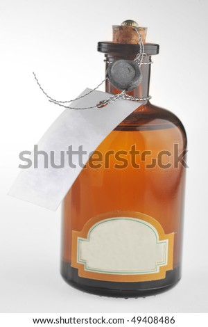bottle with  cosmetic mean closed by  stopper isolated on white #49408486
