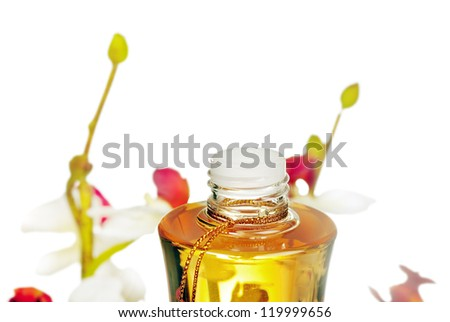 bottle with massage oil  and flowers