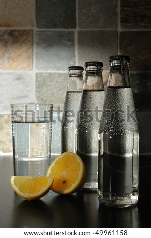 Bottle with mineral water and a lemon