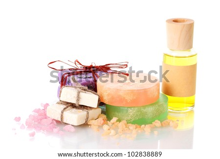 bottle with oil, soaps and sea salt isolated on white
