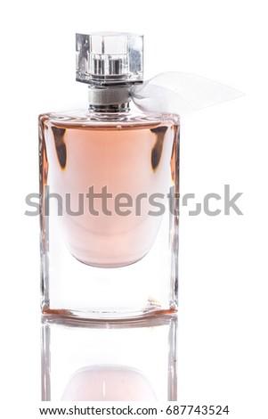 bottle with perfume isolated on white background #687743524